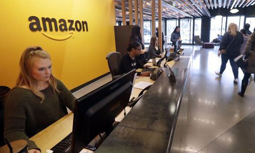 Amazon worker sitting at the front desk